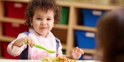 child eating USDA supplied food