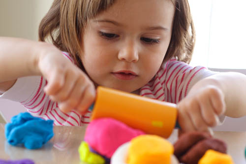 childcare girl playing with blocks